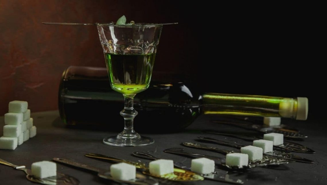 Absinthe Glass and Spoons with sugar cube