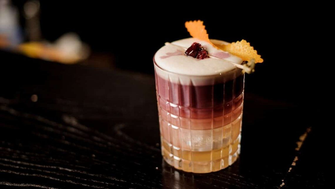 Continental Sour Cocktail with cherry garnish